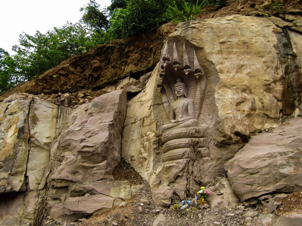 Stone carving depicting Buddha and Naga